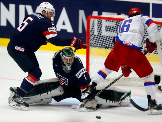 Goaltender Campbell of the US makes a save against Russia's Plotnikov during their ice hockey World Championship game against the US in Ostrava