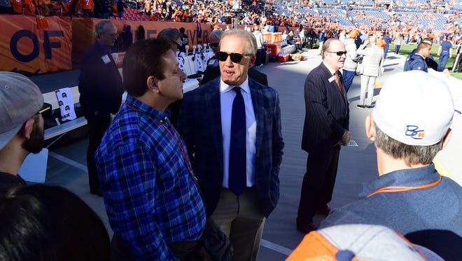 Dec 10, 2017; Denver, CO, USA; Denver Broncos president John Elway (C) looks on prior to the game against the New York Jets at Sports Authority Field at Mile High. Mandatory Credit: Ron Chenoy-USA TODAY Sports