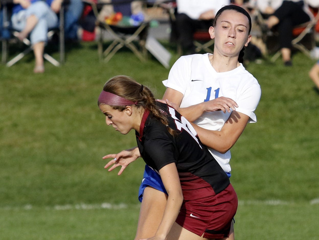 Elmira's Gabby Seymour, front, and Horseheads' Katie Masler collide while going for the ball during a 1-1 girls soccer tie Thursday at Horseheads.