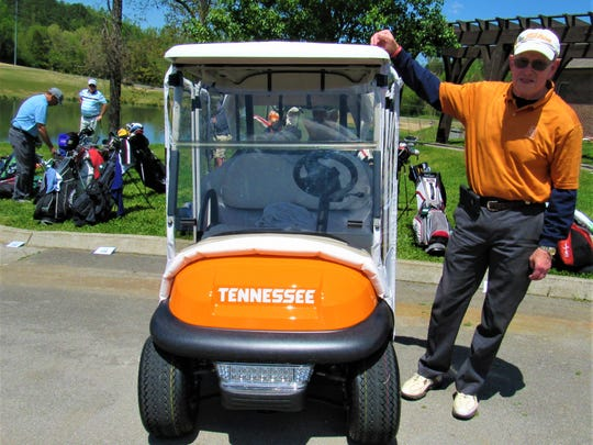 Taking Tennessee orange to a tee, Avalon resident Dr. Leonard Hines had this cart custom designed.