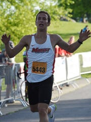 Stefan Morton crosses the finish line as the overall