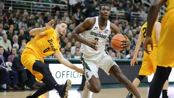 Michigan State's Jaren Jackson Jr. drives to the basket against Long Beach State's Gabe Levin of MSU's 102-60 win on Thursday, Dec. 21, 2017, at Breslin Center.