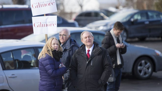 MANCHESTER, NH - FEBRUARY 09:  Republican presidential candidate Jim Gilmore greets voters outside the polling place at Webster School on primary day February 9, 2016 in Manchester, New Hampshire. Candidates from both parties are making last-minute attempts to swing voters to their side on the day of the 'First in the Nation' presidential primary.