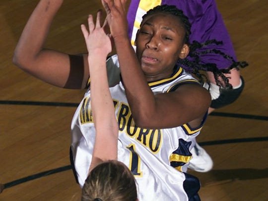 Marlboro's Chakhia Cole drives past St. Rose's  Sam Hamill during the semifinal round of the SCT at Lakewood High School in 2004.