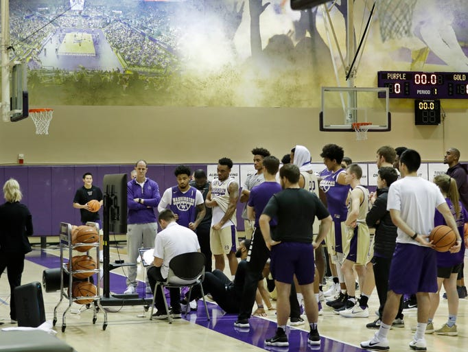 The Huskies watch video during a recent practice.