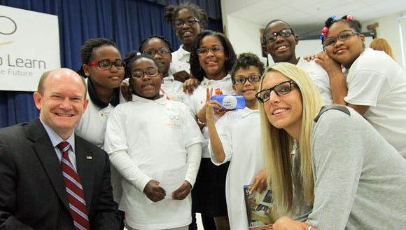 Sen. Chris Coons, left, and basketball star Elena Delle Donne joins some of the recipients of Vision to Learn glasses at Shortlidge Academy in 2014.