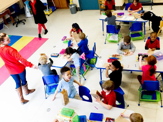 Kindergarten students in Rebecca Lambson's class create Valentine's Day bags at Spring Hill Elementary School in Knoxville on Wednesday, Feb. 14, 2018.