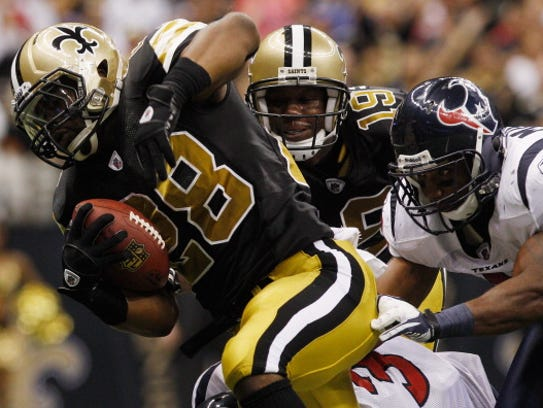Mark Ingram #28 of the New Orleans Saints scores a
