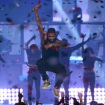 Usher jumps as he performs onstage during the 2014 iHeartRadio Music Festival at the MGM Grand Garden Arena on September 19, 2014 in Las Vegas, Nevada.