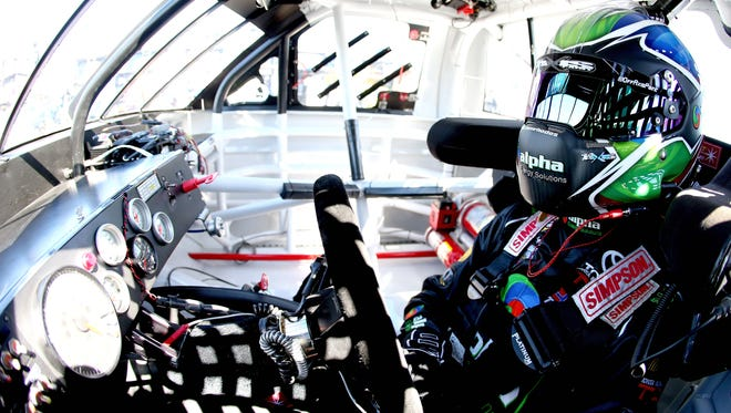 DAYTONA BEACH, FL - FEBRUARY 18: Ben Rhodes, driver of the #41 Alpha Energy Solutions Toyota, sits in his truck during practice for the NASCAR Camping World Truck Series NextEra Energy Resources 250 at Daytona International Speedway on February 18, 2016 in Daytona Beach, Florida.  (Photo by Sean Gardner/Getty Images)