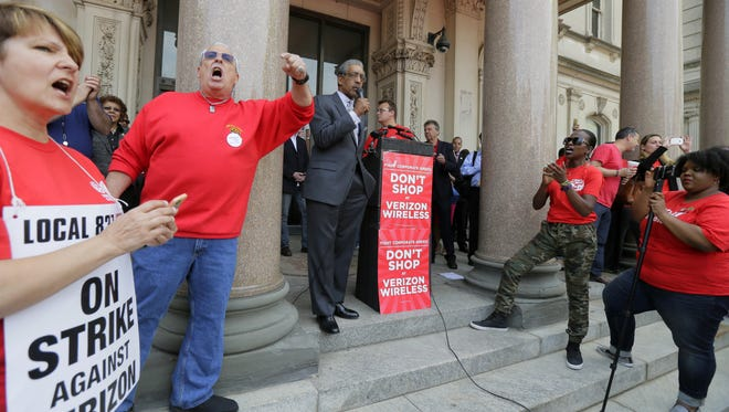 State Sen. Ronald Rice speaks as unions striking against Verizon hold a rally in front of the State House in Trenton on April 25.