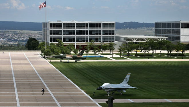 A cadet walks between classes at the U.S. Air Force Academy, near Colorado Springs, Colo., Tuesday Aug. 27, 2013.