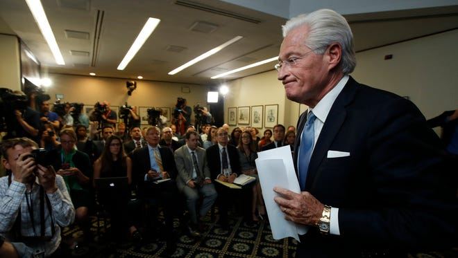 Marc Kasowitz, personal attorney of President Trump, leaves a packed room at the National Press Club in Washington on June 8, 2017.