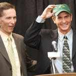 Houston football coach Art Briles, right, is introduced as the new Baylor football coach by Baylor athletic director Ian McCaw during a news conference Wednesday, Nov. 28, 2007, in Waco, Texas.