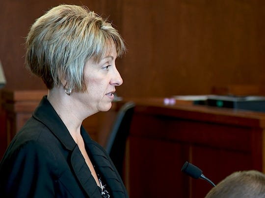 Deputy County Attorney Angela Adams cross-examines a defense witness in a case involving a juvenile accused of bringing a bomb to Pine View High School and vandalizing Hurricane High School with ISIS messages July 13, 2018.
