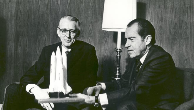 President Richard M. Nixon and Dr. James C. Fletcher, NASA Administrator, discussed the proposed Space Shuttle vehicle in San Clemente, California, on January 5, 1972. The President announced that day that the United States should proceed at once with the development of an entirely new type of space transportation system designed to help transform the space frontier into familiar territory.