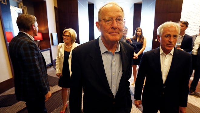Senators Lamar Alexander, center, and Bob Corker, right, are seen before a unity rally with U.S. Rep. Diane Black and Randy Boyd (behind left) at the Omni Hotel Aug. 4 in Nashville.