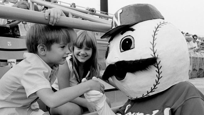 The Nashville Sounds mascot greets a couple of kids in the stands of Greer Stadium before the start of the Sounds game with Montgomery Rebels July 29, 1978.