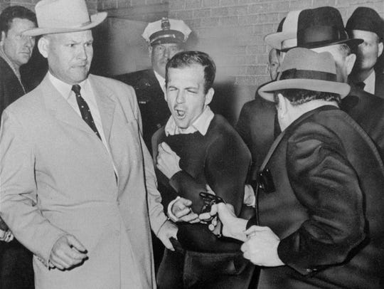 Jack Ruby, right, shoots and kills Lee Harvey Oswald