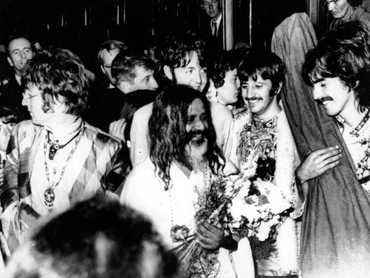 The Beatles join the Maharishi Mahesh Yogi, center, as they arrive by train at Bangor, Wales, to participate in a weekend of meditation, on Aug. 26, 1967. The Maharishi is the founder of the International Meditation Society. From left to right are John Lennon, Paul McCartney, Ringo Starr and George Harrison.