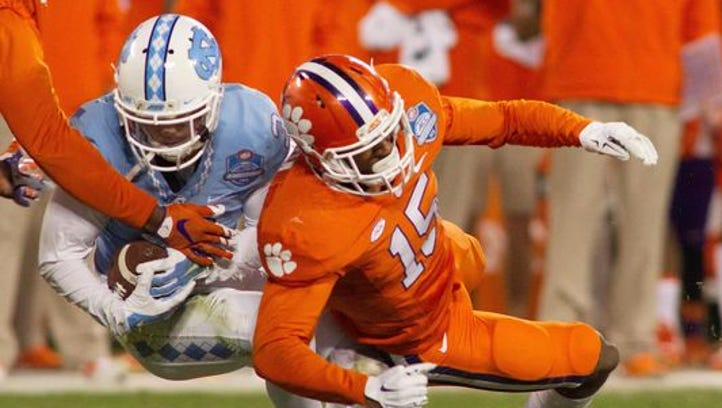 Clemson safety T.J. Green (15) leaves the field after being ejected for targeting against North Carolina during the 2nd quarter of the ACC Championship at Bank of America Stadium in Charlotte Friday, Dec. 4, 2015.