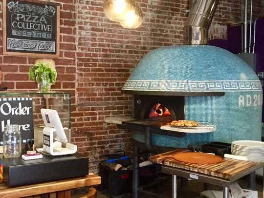 The wood-fire pizza oven at the Pizza Collective in