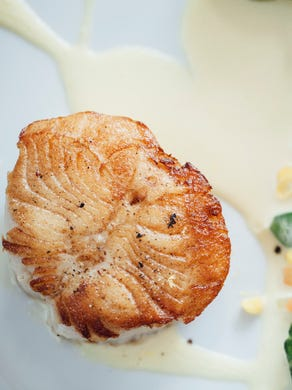 St. Genevieve beautifully presents a scallop small plate.