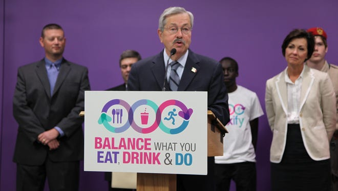Gov. Terry Branstad speaks Tuesday at a news conference touting the soft-drink industry's campaign to encourage reasonable consumption of soda.