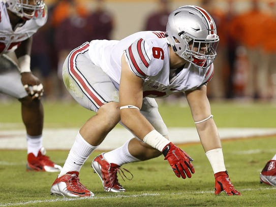 Ohio State Buckeyes defensive end Sam Hubbard (6) lines up against the Virginia Tech Hokies at Lane Stadium.