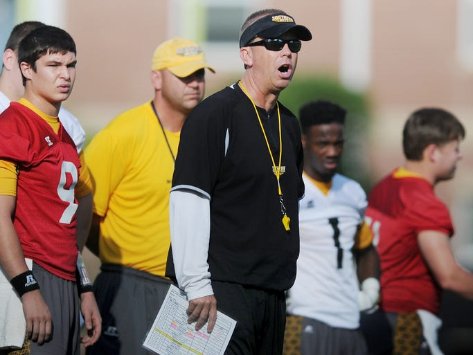 Univerisity of Southern Mississippi's head football coach Todd Monken talks to his players Saturday during football practice at the University's Joe P. Park Practice Facility.