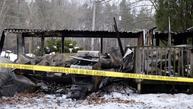 This mobile home in Leslie Township was completely destroyed in a fire Wednesday night. One person was found dead inside the house after the fire was extinguished.