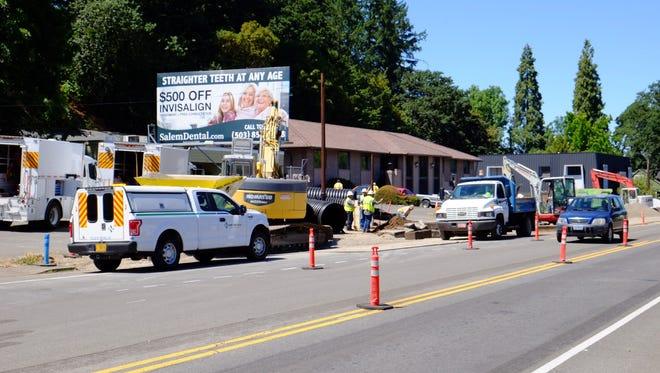 A construction crew hit a gas line on 12th Street, causing a leak, which closed several nearby streets Thursday.
