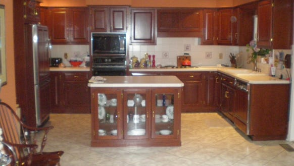 """The kitchen """"before"""" had poor counter space and a tired-looking"""