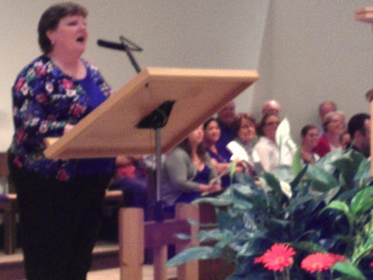 St. Columban music director Mary Bellman led the choir, the brass quintet, and paid tribute to military veterans during a 70-year D-Day remembrance concert at St. Columban Church Friday, June 6.