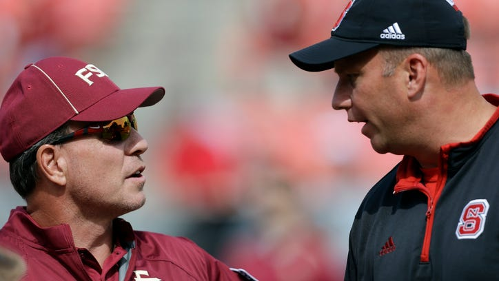 Florida State coach Jimbo Fisher, left, and North Carolina State coach Dave Doeren speak prior to an NCAA college football game in Raleigh, N.C., Saturday, Sept. 27, 2014.