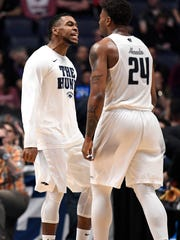 Nevada forward Jordan Caroline (24) celebrates with