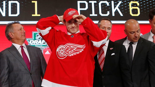 Filip Zadina puts on a Detroit Red Wings jersey and hat after being selected with the No. 6 overall pick in the NHL draft in Dallas, June 22, 2018.