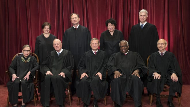 FILe - In this June 1, 2017, file photo, the justices of the U.S. Supreme Court gather for an official group portrait to include new Associate Justice Neil Gorsuch, top row, far right at the Supreme Court Building in Washington. Seated, from left are, Associate Justice Ruth Bader Ginsburg, Associate Justice Anthony M. Kennedy, Chief Justice John Roberts, Associate Justice Clarence Thomas, and Associate Justice Stephen Breyer. Standing, from left are, Associate Justice Elena Kagan, Associate Justice Samuel Alito Jr., Associate Justice Sonia Sotomayor, and Associate Justice Neil Gorsuch. The 81-year-old Kennedy said Tuesday, June 27, 2018, that he is retiring after more than 30 years on the court.