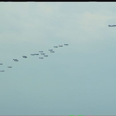More than 20 World War II era aircraft flew down the