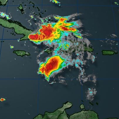 Erika was downgraded to a remnant low early Saturday.