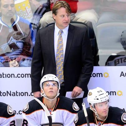 Anaheim Ducks assistant coach Brad Lauer on his bench