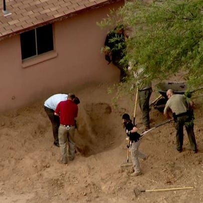 Pinal County Sheriff's Office investigators dig for