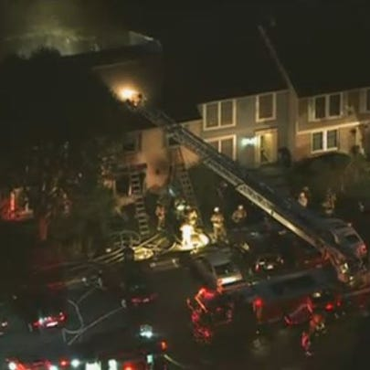 Fire crews respond to a townhouse fire in Reston on