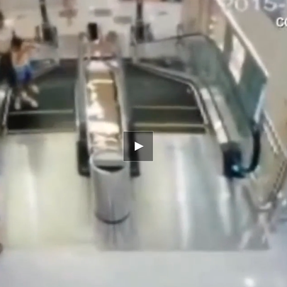 Woman saves son before falling to her death in escalator