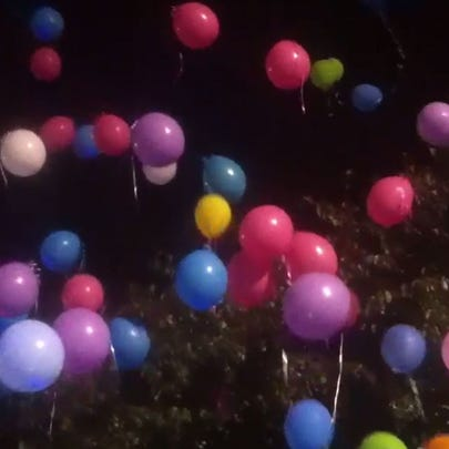 Balloons released in memory of three victims