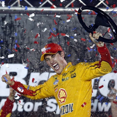 Sprint Cup Series driver Joey Logano (22) celebrates