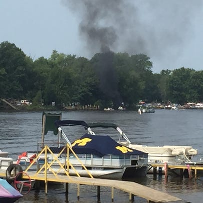 Boat fire on the Grand River near Riverside County