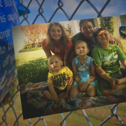 A memorial is set up for 21-month-old Lonzie Barton