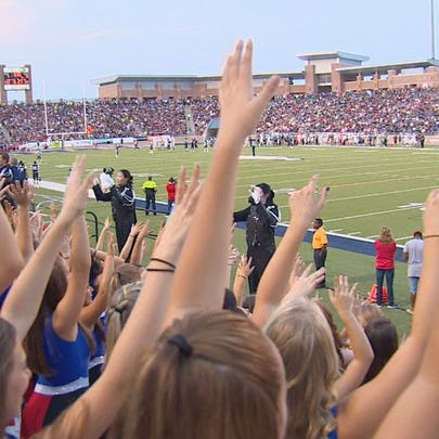 Fans cheer the reopening of Eagle Stadium in Allen.