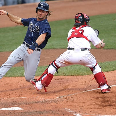 John Jaso #28 of the Tampa Bay Rays scores by Ryan